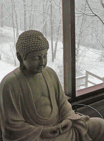 Snow buddha on porch