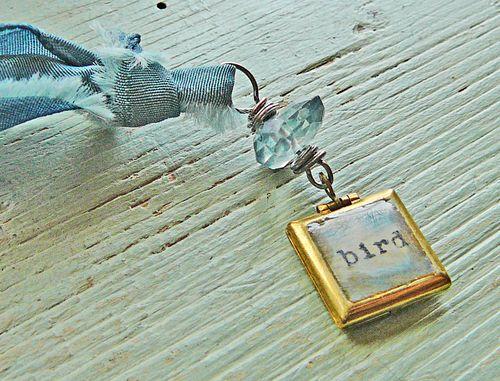 Locket detail with bird
