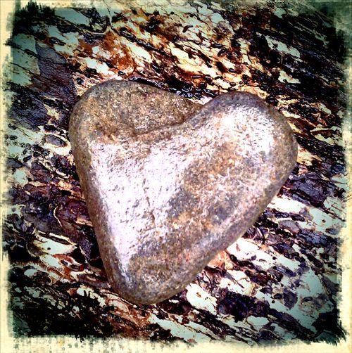 Heart rock in rain