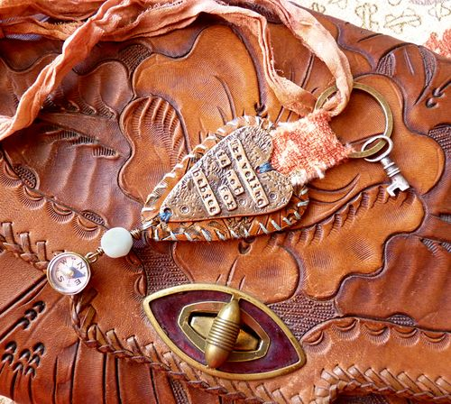 Traveling keyring on tooled leather purse