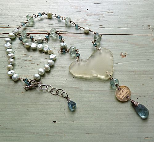 My start heart necklace on table
