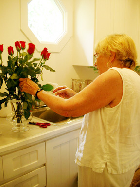 Mama_arranging_altar_flowers_for_orn_1